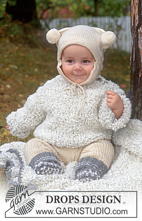 DROPS Children 9-24 - Jersey and blanket in Big Bouclé. Trousers, hat and socks in Karisma